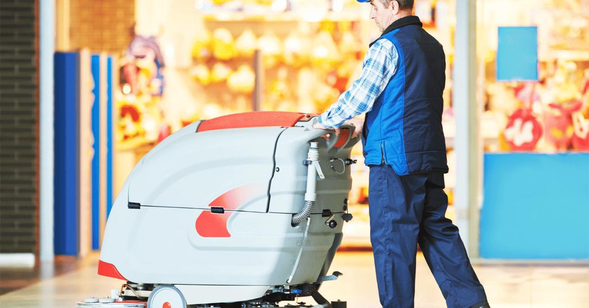 worker power scrubbing a retail store