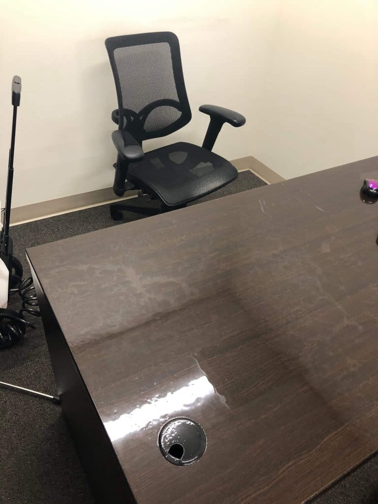 Office desk still wet from disinfectant