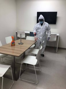 crew member disinfecting table